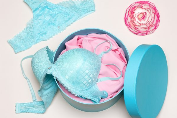 close-up-of-open-round-gift-box-with-blue-lingerie-set