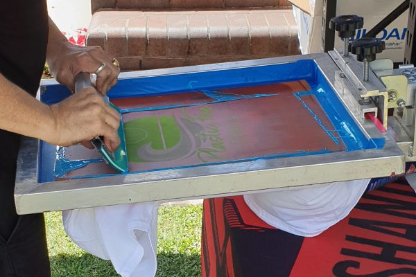 person-using-squeegee-for-screen-printing